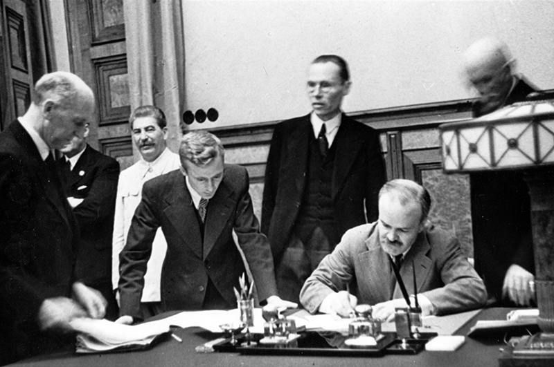 Signing of the Molotov-Ribbentrop Pact; treaty between Germany and the Union of Soviet Socialist Republics (USSR), signed in Moscow on August 23, 1939Чa few days before the beginning of World War IIЧby Nazi foreign minister Joachim von Ribbentrop and Soviet commissar for foreign affairs Vyacheslav Molotov (in the pic., sitting), and in the presence of Soviet dictator Joseph Stalin. Standing (l-r) - Joachim von Ribbentrop, Iosif Stalin, V. Pavlo and F. Gauss.